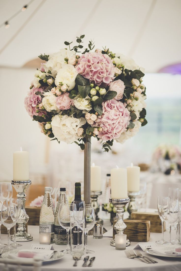 Blush & White Floral Centrepieces - Amy Shore Photography | PapaKåta Sperry Tent in Yorkshire Countryside | Sottero and Midgley Quinlynn Wedding Dress | Pink Dessy Bridesmaid Dresses | Blush & White Roses, Hydrangeas & Peony Flowers