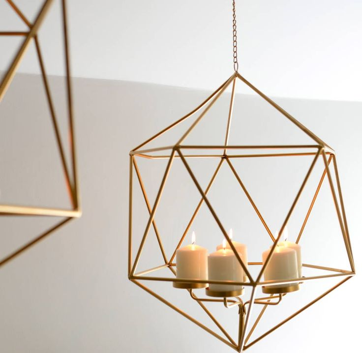 A hexagomal, gold hanging candle holder.These hanging candle holders look amazing hung on their own or as a pair or more. They are quite large, so have a great impact on a space and really add a funky modern feel to any room. They would also be great for weddings and functions, or hang one in your hallway at Christmas to be the envy of your friends!metalH: 620mm W: 600mm