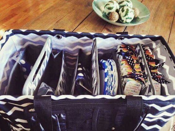 Three double duty caddies in a large utility tote. Check ...