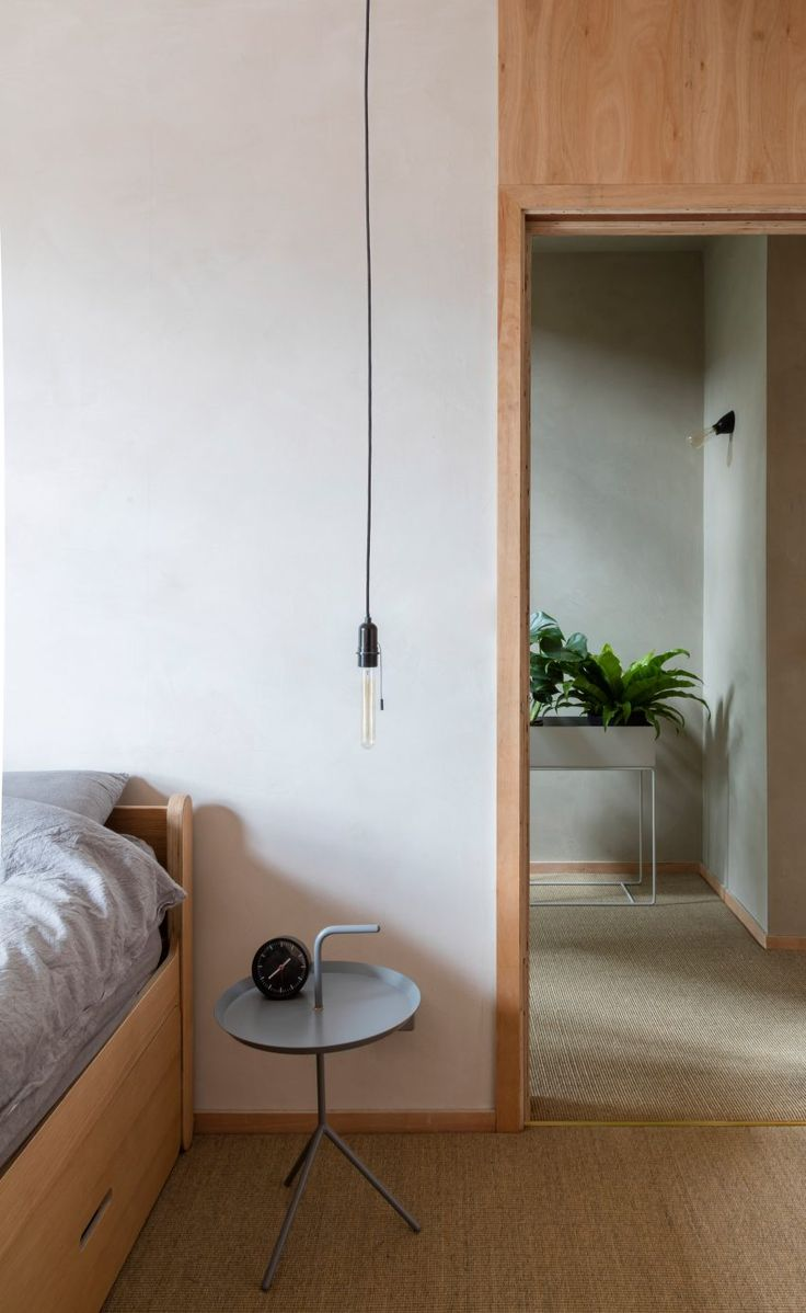 Layers of coarse clay line the walls of this London apartment, which has been overhauled by architect Simon Astridge to include a bathing area with tatami matting and smoked-oak panelling