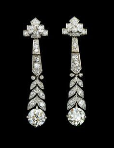 A Pair of Art Deco Platinum and Diamond Earrings, Cartier, 6.40 dwts.
