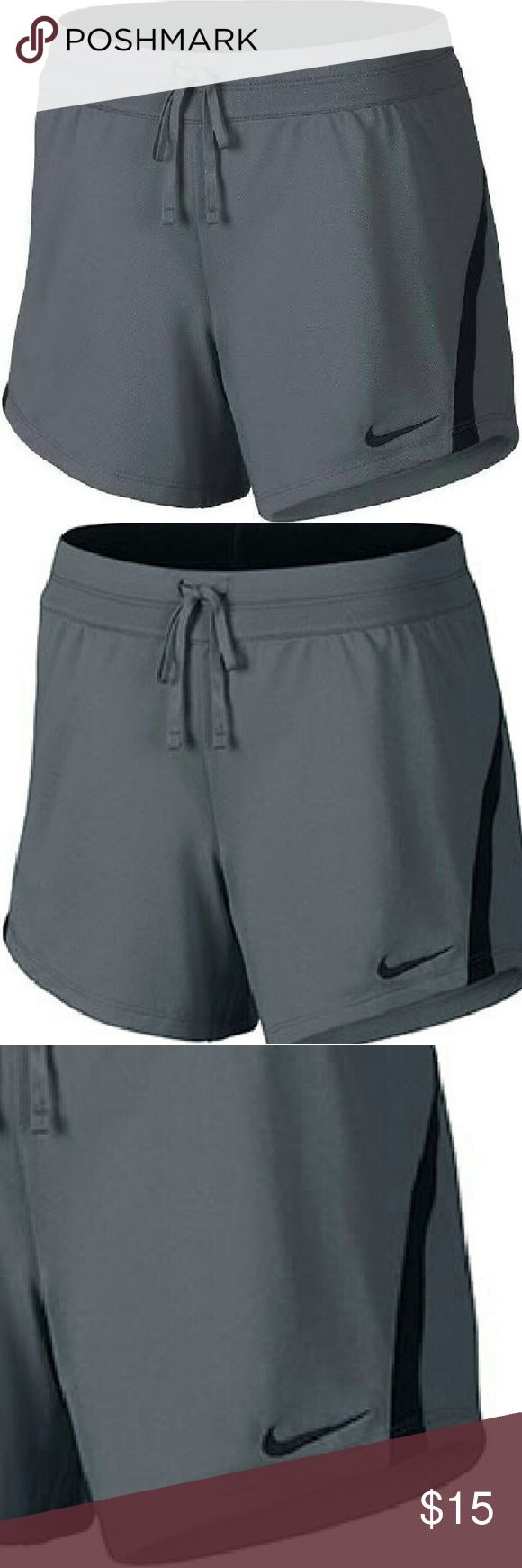 Nwt Women's Nike shorts This is a new pair of women's Nike shorts in grey and black Nike Shorts