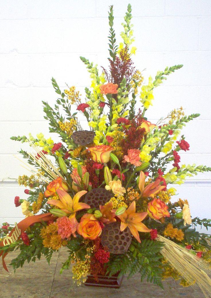 Fall funeral arrangement lots of flowers