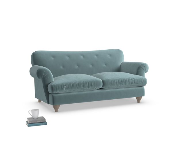 Our Marmalade sofa is a classic British style sofa. It has lovely curves and back-button detail. It comes in a choice of over 60 fab fabrics.