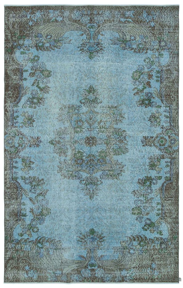 "For a contemporary look with abstract appeal, this blue over-dyed rug is skillfully crafted by the revitalization of a hand knotted vintage Turkish rug. Made from wool on cotton, this ""distressed"" rug measures 171 cm x 270 cm. The process in creating these works of art begins by shearing to lower the pile and to help ""distress"" them. They then undergo a series of processes to remove the color. They are now ready to be dyed in one color, a stage that can be repeated several times to reach th…"