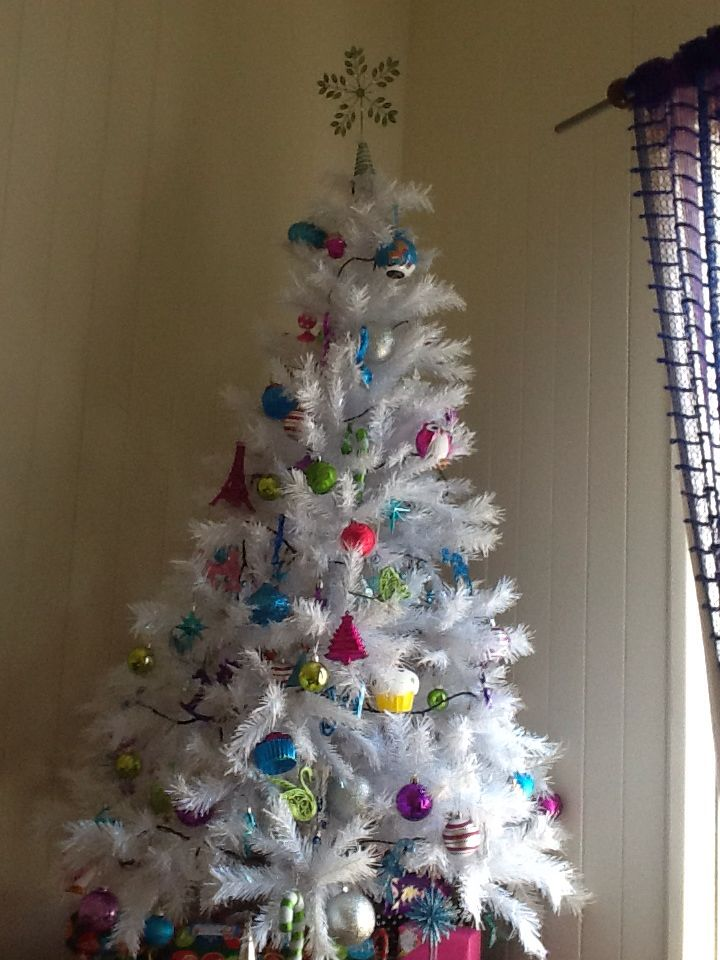 This is my beautiful christmas tree with a pink, blue, green, purple, and all things girly as the decorations!!