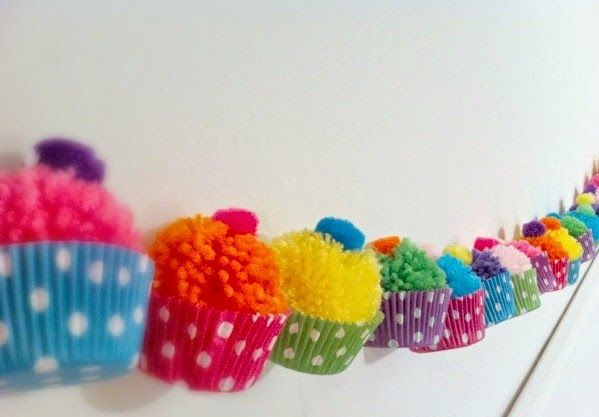 Cupcakes. Party decor easy! Pompoms, cupcake cases and buttons!!! Super cute party bunting decoration!