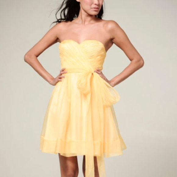 Ivy & Aster Yellow Sweetheart Dress This is Ivy & Aster's Fall 2012 Bridesmaid Dress 'Sparkle'. It is a knee-length strapless (spaghetti straps included for option) butter yellow chiffon A-line dress with a sweetheart neckline and bow sash. This dress is so beautiful! Worn only once for a wedding...I bought for around $300. Perfect condition! I have two of these (both size 0) since my sister and I were both in the wedding ☺ These fit true to size and have not been altered. **No trades** J…