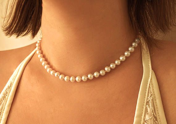 The classic real freshwater pearl necklace in backdrop style! The necklace is made in the classic hand-knotted style. The reason of this method is to protect the pearls. The pearls are pricey, you can keep the condition of the pearls if they dont rub each others. And since the classic pearl necklace is made by natural silk cord, that is a sensitive material, in case it gets broken, the pearls wont run everywhere, you dont risk to lose them. Usually the weakest point of these...