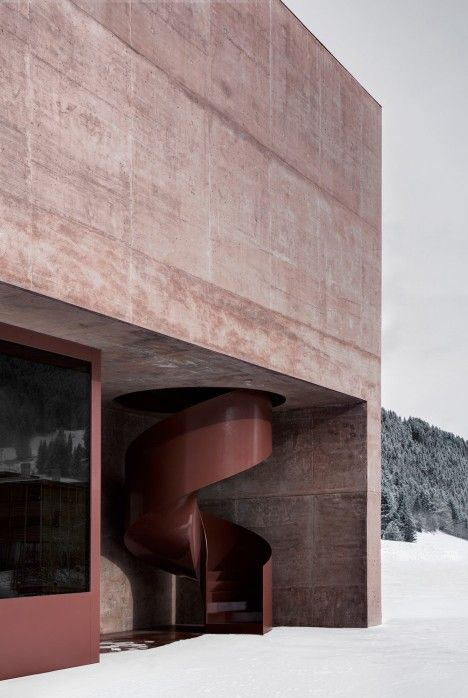 Italian studio Pedevilla Architects has used red pigmented concrete to give an Alpine fire station in South Tyrol a muted yet distinctive colouring