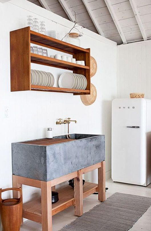 white smeg fridge in minimalist modern kitchen, metal sink, wooden shelves with draining rack
