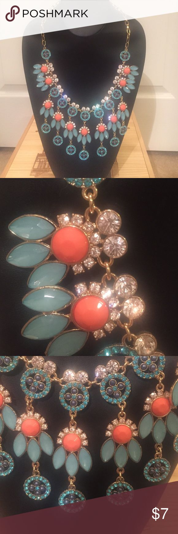 Blue and Orange Statement Necklace This necklace is definitely for someone who wants to make a STATEMENT. Blue, orange, turquoise and rhinestones. Charming Charlie Jewelry Necklaces