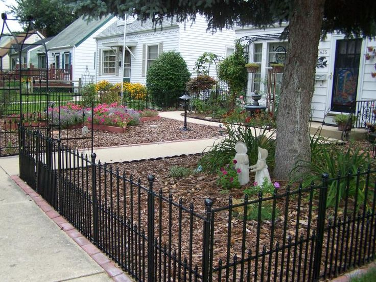 Wrought Iron Fence in Front Yard. Lowes has this option in no dig at around $25 a panel... I literally just finished doing this to a section of ,y backyard where u walk off my back porch for the doggies :)