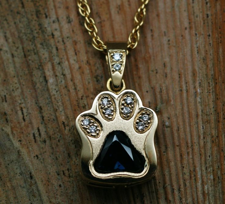 Paw pendant Handmade cat paw with blue sapphire trilliant and argyle white diamonds in recycled 18 carat yellow gold with a recycled gold chain