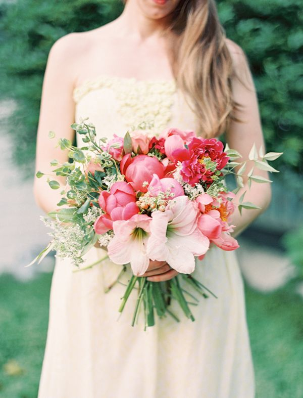 coral charm and magenta peonies, peach amaryllis, hypericum berries and greenery by Fern Studio, image by Jordan Thompson of Landon Jacob