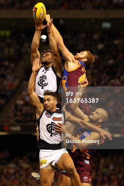 Daniel Merrett of the Lions attempts to spoil a mark by Levi Casboult of the Blues during the NAB Cup AFL Grand Final between the Carlton Blues and the Brisbane Lions at Etihad Stadium on March 15, 2013 in Melbourne, Australia.  GOD, I miss AFL!