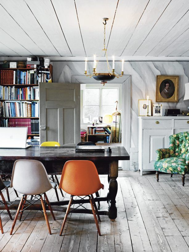 I would move in, in a minute. Love the mid-century modern chairs (especially the orange one) mixed with farmhouse and traditional accessories and furniture | EB & Kris