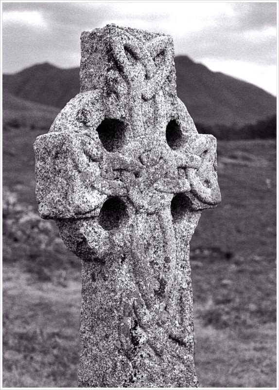 Beautiful old Celtic cross in dramatic black and white, love those hills.