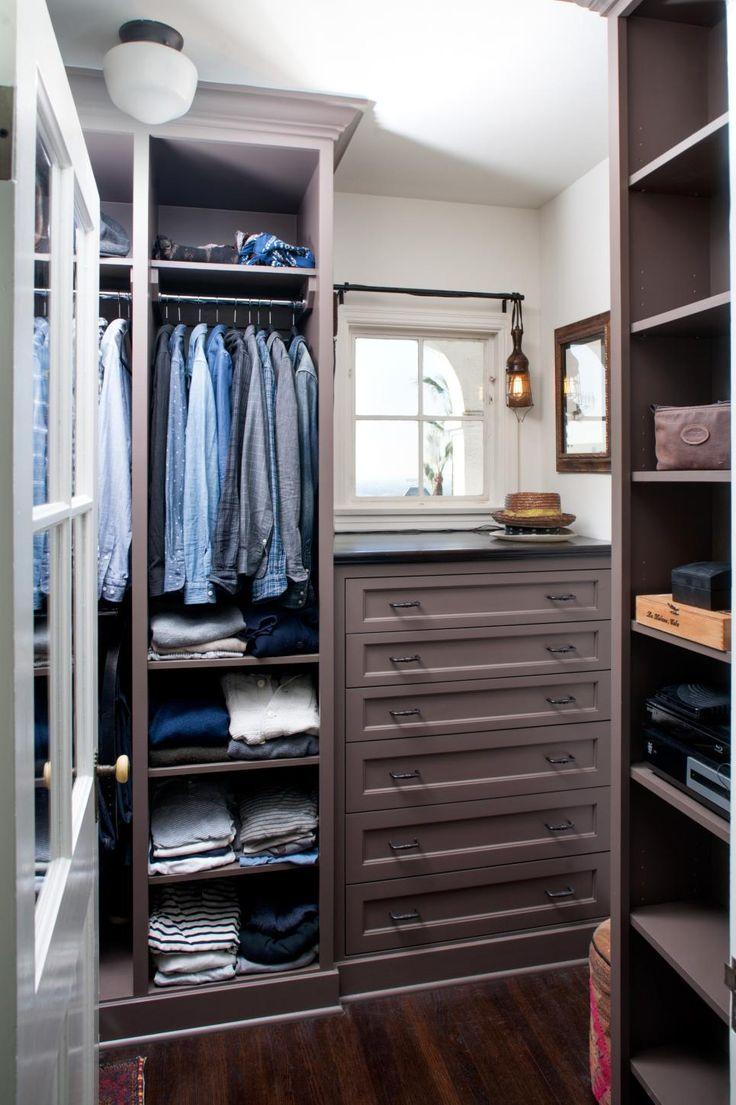 Builtin storage fixtures provide maximum storage in this mens walkin closet Drawers are