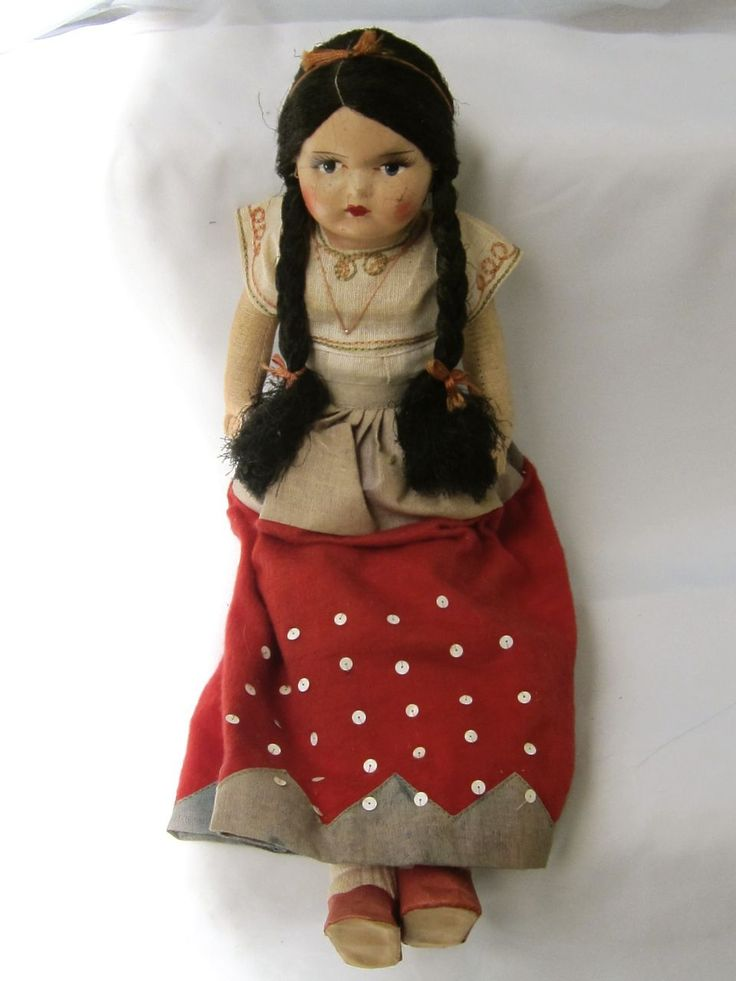 There vintage mexican doll