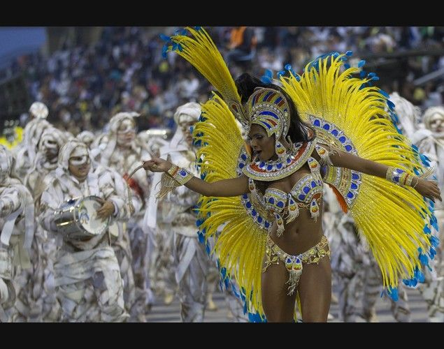 LOVE this picture of a dancer from the Imperio de Casa Verde samba school performs during a carnival parade in Sao Paulo, Brazil, Sunday, Feb. 10, 2013.