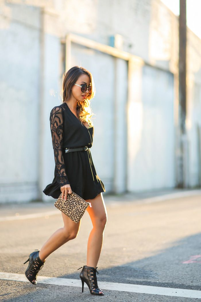 Kim Le is wearing a black lace romper from Morning Lavender and the shoes are from Nine West