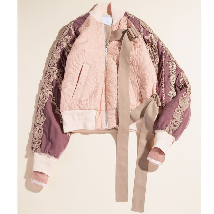 Sacai: textured bomber jacket with Oriental bows.