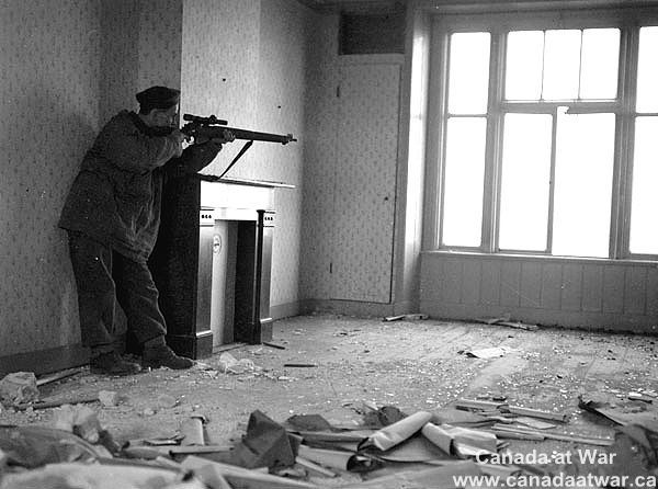 The Netherlands - Sniper Arthur Godin, of the Regiment de la Chaudiere, 3 Canadian Infantry Division, during the fighting for. Zutphen, Netherlands, 7 April 1945.