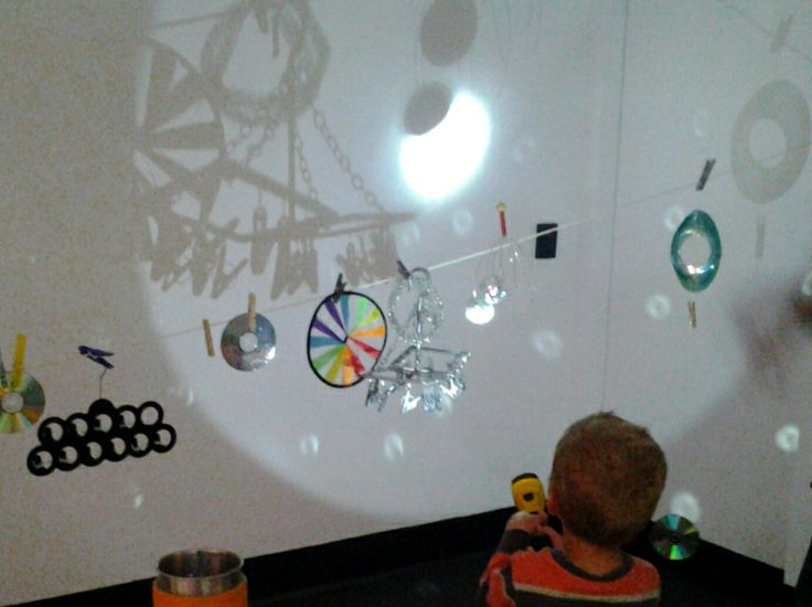 """""""shadow sculptures. He loved shining the torch on the disco ball and making it reflect off all the walls. I used the sculptures behind him to show him how translucent objects can cast coloured shadows and how moving the torch further/closer and side to side affects the shadow""""-Racheous"""