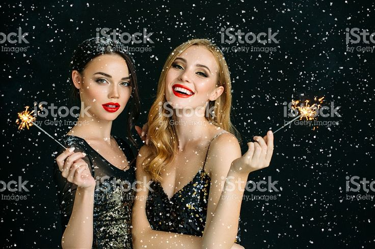 Photo of two laughing girls strewn snow royalty-free stock photo