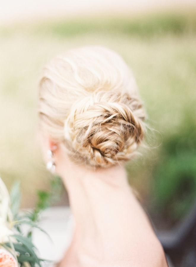 Gorgeous braided bun updo: http://www.stylemepretty.com/ohio-weddings/cleveland/2016/03/28/timeless-elegant-cleveland-city-hall-wedding/ | Photography: Lauren Gabrielle - http://laurengabrielle.com/