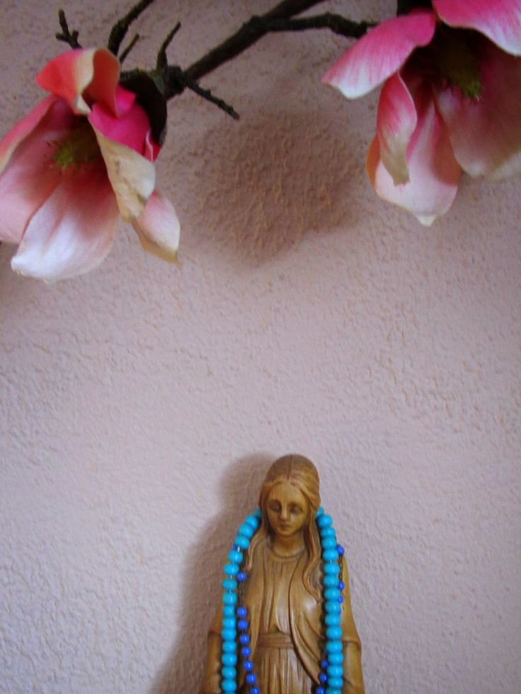 The virgin Mary with flowers, rosary and mala