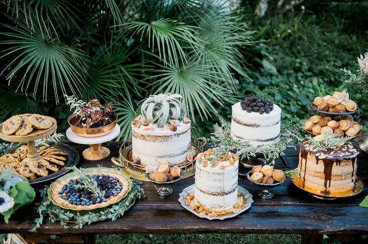 Love this table filled with organic cakes!