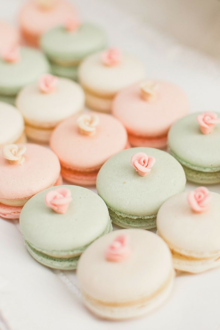 Mint peach and cream french macarons with roses as dessert