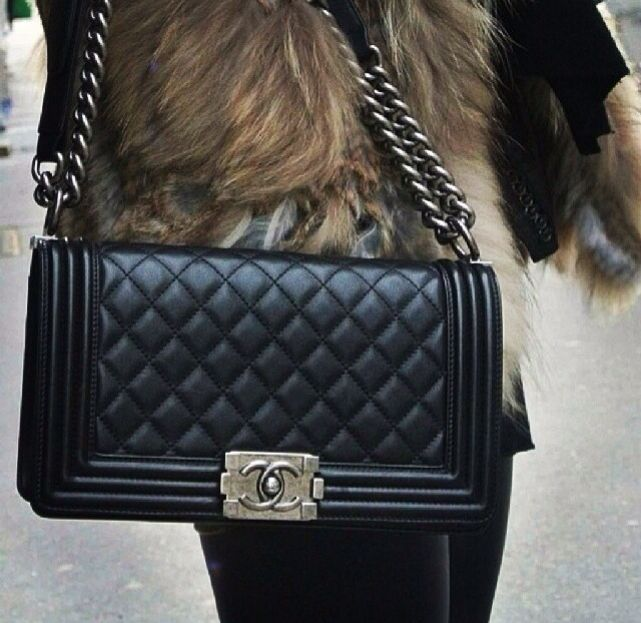 Want want this...only want, not a need. Hahaha. Chanel boy bag! In black or marine blue.