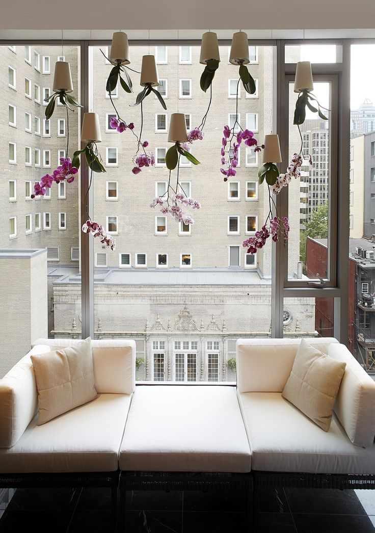 Large glass windows offer unabated views of the city skyline