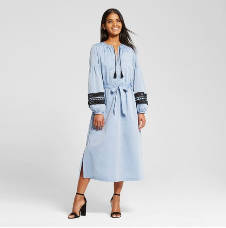 Pale blue long-sleeved midi-length caftan with black embroidery, tie waist, long sleeves, black ties at neck with tassels, slits at sides