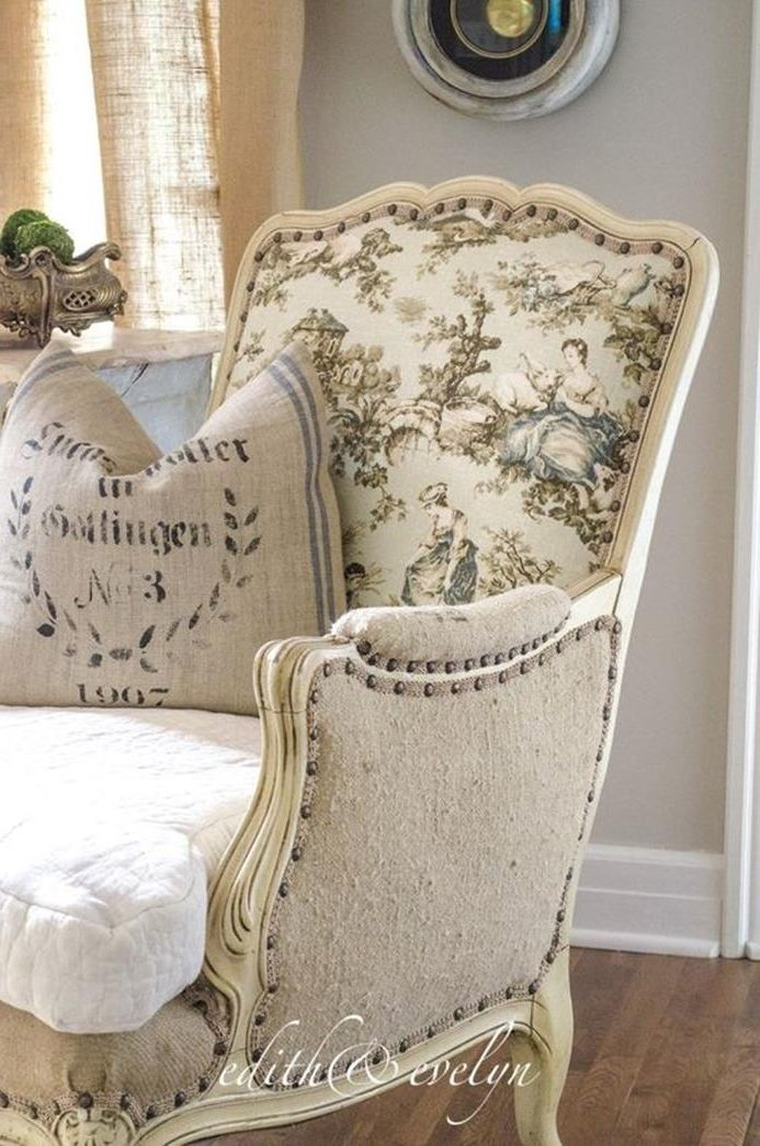 antique pattern on cream fabric, covering a vintage wing chair, with ivory and beige detailing, white and beige cushions