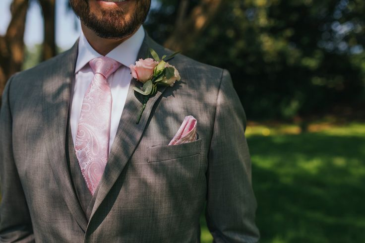Smart, stylish and classic - perfection. Photo by Benjamin Stuart Photography #weddingphotography #groom #suit #greysuit #3piecesuit #pinktie #weddingday #weddingsuit