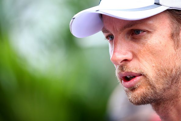 Jenson Button of Great Britain and McLaren speaks with members of the media inthe paddock during previews ahead of the United States Formula One Grand Prix at Circuit of The Americas on October 30, 2014 in Austin, United States.