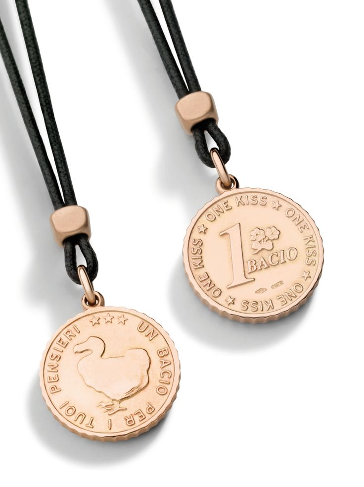 Heads or tails? Play with Dodo's rose gold coin charms!