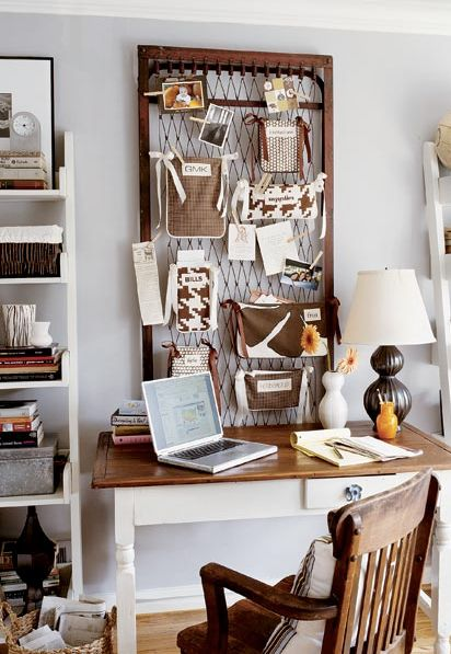 (I love the bulletin board!) rustic desk with turned legs, reclaimed iron bedframe bulletin board, black gourd lamp and white ladder bookshelves.