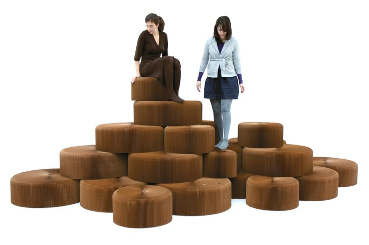 A seating hill made from paper. molo softseating fanning stools stack to form complex seating topographies. http://molostore.com/category-furniture