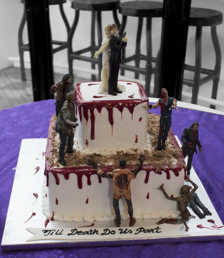 "My Purple Wedding--Grooms Zombie Cake. He designed this himself. All the zombie figures are from ""The Walking Dead"" series which you can purchase from ebay."