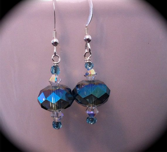 Swarovski crystal dangle earrings with lovely shades of teal and blue. These are made with all Sterling Silver findings. Would make the perfect gift