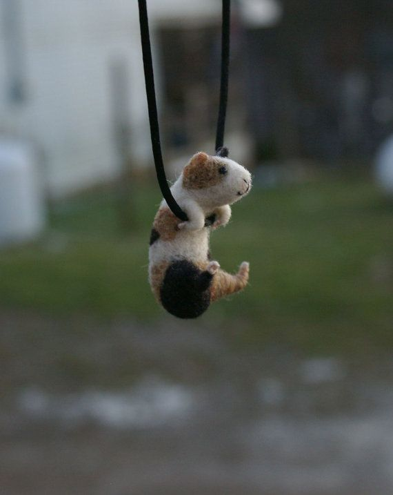Tiny Guinea Pig Necklace / sculpture  needle by motleymutton