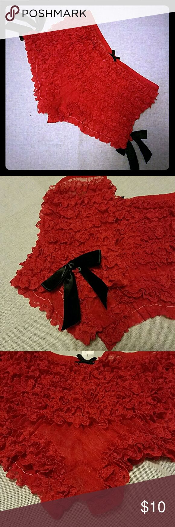 Frederick's of Hollywood Ruffle Red Panties Perfect for Valentine's Day! Sexy red sheer ruffled boy short panties accented with silky black bows on the side and at the top front. Beautiful lace makes up the ruffles. Bought with a plan. Plan changed. Worn once to try on, never worn again. Perfect condition. Frederick's of Hollywood Intimates & Sleepwear Panties