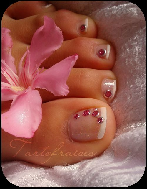 french tips and pink jewels  idk if i'd put a big jewel like that on every toe but the big toe is def cute!