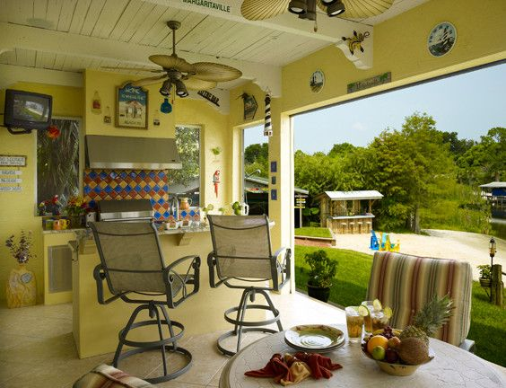 tropical summer kitchen with yellow wall, ceilig fans, colorful tiles and colorful chair of Welcoming Summer with Cooking Al Fresco