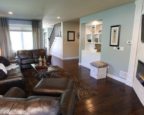 Hardwood floor color, wall color and curtains, stairs panel and rail. Basement layout with hall and corner gas fireplace.